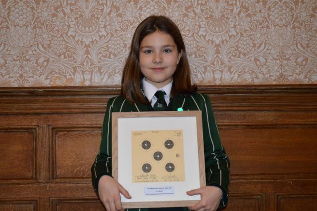 Adelaide Sillar holding her record scoring target