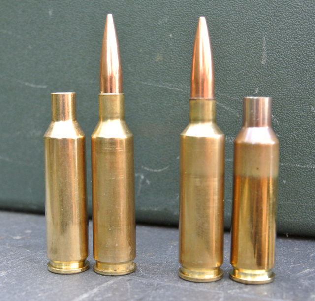6XC left and 6mmSmack right, flanked by their parent cases.  The 6XC can be shot straight out of the box – unlike the Smack, which requires necking-down and fireforming